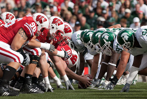 Wisconsin linemen face off at the line of scrimmage with Michigan State University players during a football game at Camp Randall Stadium at the University of Wisconsin-Madison on Sept. 29, 2007. Wisconsin won game, 37-34. ©UW-Madison University Communications 608/262-0067 Photo by: Jeff Miller Date: 09/07 File#: NIKON D200 digital frame 2041